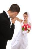 Attraktive Braut und Bräutigam an der Hochzeit Stockfotos