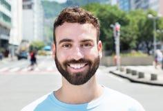Attraktive caucasian man with beard. Outdoor in city Royalty Free Stock Photos