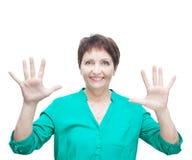 Attraktive emotionale Frau 50 Jahre alt, lokalisiert auf weißem backg Stockfotografie