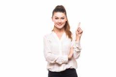 Attraktive Frau, die oben zeigt stockfotografie