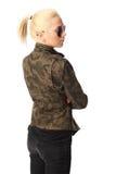 Attraktive Frau in einer Militärjacke Stockfotos