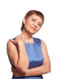 Attraktive Frau 50 Jahre im blauen Kleid Stockbilder