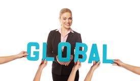 Attraktive Frau mit dem Wort GLOBAL stockbilder