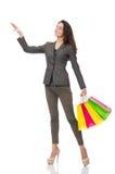 Attraktive Frau mit den Einkaufstaschen an lokalisiert Stockbild