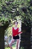 Attraktive Frau mit Frühlingsbaum Lizenzfreies Stockfoto
