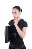 Attraktive Frau mit ledernem Fall Lizenzfreie Stockbilder