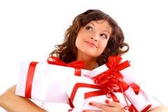 Attraktive Frau mit vielen Geschenk Stockfotografie