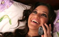 Attraktive Frau am Telefon Stockbilder