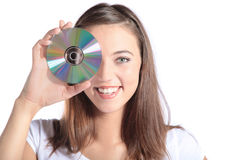 Attraktive Frauenholding CD-ROM stockfoto