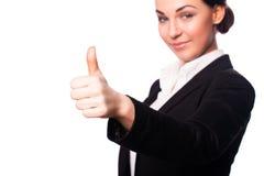 Attraktive Geschäftsfrau mit dem Daumen herauf Geste Stockfoto