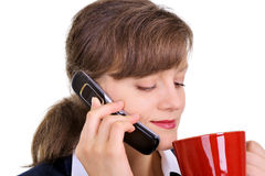 Attraktive Geschäftsfrau mit einem Tasse Kaffee Lizenzfreie Stockfotos