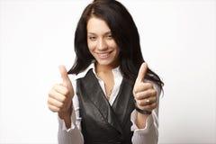 Attraktive Geschäftsfrau mit ihren Daumen oben angehoben stockfotos