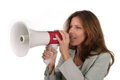 Attraktive Geschäftsfrau mit Megaphon 2 stockbild