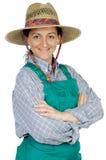 Attraktive glückliche Frau gekleideter Gärtner Stockbilder