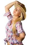 Attraktive junge Frau im Cowboykleid und -hut stockbilder