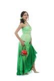 Attraktive junge Frau im grünen Kleid Stockfotografie