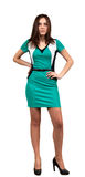 Attraktive junge Frau im grünen Kleid Stockbild