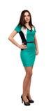 Attraktive junge Frau im grünen Kleid Stockbilder
