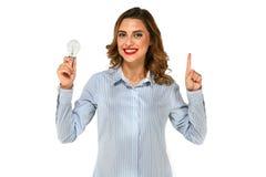 Attraktive junge Frau mit Birne lizenzfreies stockbild