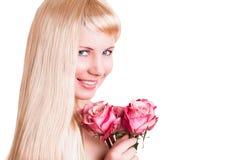 Attraktive junge Frau mit einer Rose Stockfoto