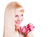 Attraktive junge Frau mit einer Rose Lizenzfreie Stockbilder