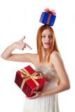 Attraktive junge Frau mit Geschenkkästen Stockbilder