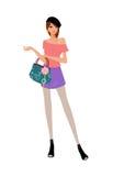 Attraktive junge Frau mit Handtaschenstellung Lizenzfreie Stockbilder