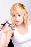 Attraktive junge Frau mit Scheren stockbilder