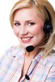 Attraktive lächelnde Blondine mit einem Kopfhörer Stockbilder
