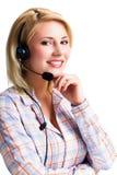 Attraktive lächelnde Blondine mit einem Kopfhörer Stockfoto