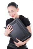 Attraktive lächelnde Frau mit ledernem Aktenkoffer Lizenzfreie Stockfotos