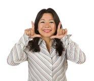 Attraktive multiethnische Frau, Hände, die Gesicht gestalten Stockbilder