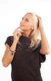 Attraktive träumerische blonde Frau Stockfoto