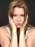 Attraktive unglückliche deprimierte junge Frau Lizenzfreie Stockbilder