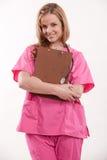 Attraktiver blonder weiblicher kaukasischer Krankenschwesterdoktor Stockfotos