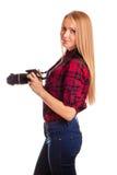 Attraktiver Frauenphotograph bei der Arbeit mit DSLR Lizenzfreies Stockbild