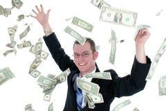 Attraktiver Geschäftsmann in Klage-werfendem Geld in Luft Lizenzfreies Stockbild