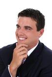 Attraktiver junger Geschäftsmann beim Klage-Lächeln Stockfotografie