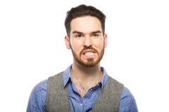 Attraktiver junger Kerl, der im Studio aufwirft Lizenzfreie Stockfotografie