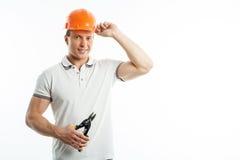 Attraktiver junger Vorarbeiter ist bereit zu arbeiten Lizenzfreie Stockfotografie