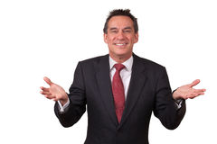 Attraktiver lächelnder Mann in der Klage mit den geöffneten Händen Stockfoto