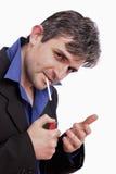 Attraktiver Mann, der eine Zigarette beleuchtet Stockfotos