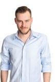 Attraktiver Mann gegen weißen Hintergrund Stockfotos