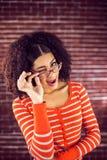 Attraktives Blinzeln der jungen Frau Lizenzfreies Stockbild