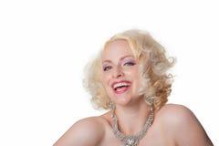 Attraktives blondes Frauenlachen Stockfotografie