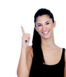 Attraktives Brunettemädchen mit dem Finger oben Stockfotos