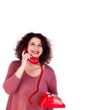 Attraktives curvy Mädchen, das mit einem roten Telefon nennt lizenzfreies stockbild