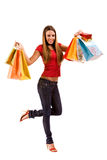 Attraktives Einkaufenmädchen mit bunten Beuteln Stockfotos