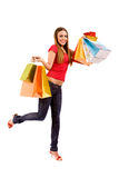 Attraktives Einkaufenmädchen mit bunten Beuteln Stockbild