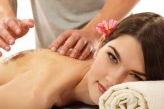 Attraktives jugendlich Mädchen des Massagehonigs Stockfoto